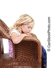 Sad girl sitting in chair