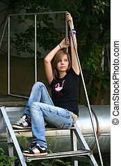 Sad girl - Teenage girl siiting against wall in a depressed...