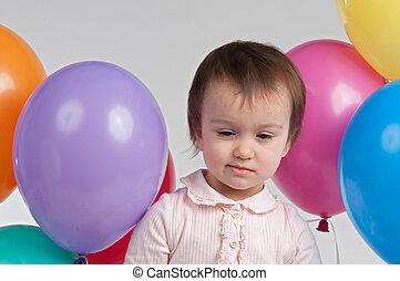 Sad girl with balloons