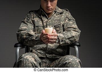 Sad handicapped male veteran praying