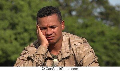 Sad Hispanic Male Soldier Wearing Camo