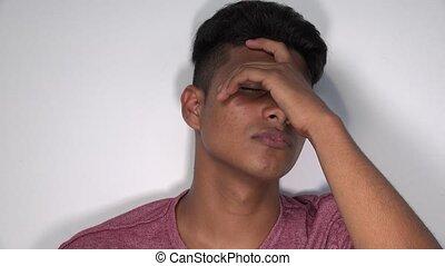 Sad Hispanic Male Teen