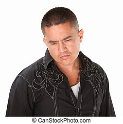 Sad middle-aged Native American man on white background looks down