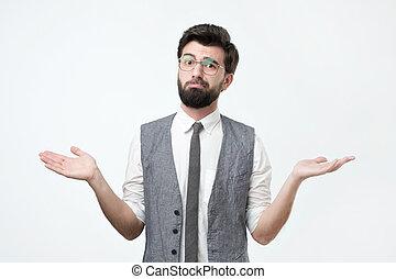 Sad hispanic man throws up his hands