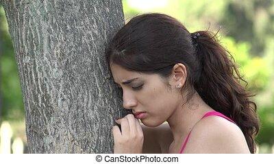 Sad Hispanic Woman