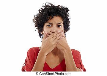 sad hispanic woman with hands on mouth