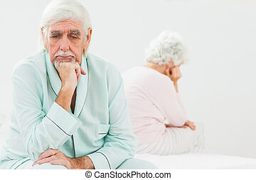 Sad husband not talking to wife