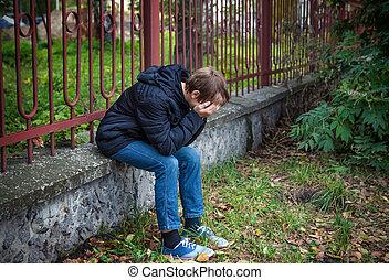 Sad Kid outdoors