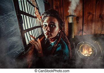 Sad lady near the window in the prison.