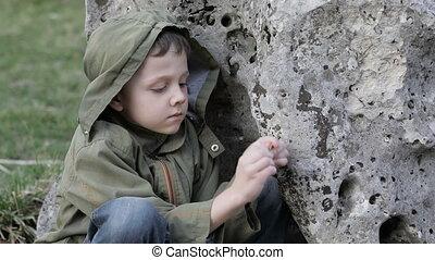 sad little boy outdoors