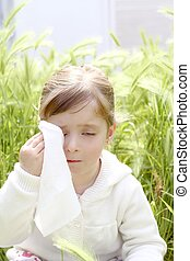 sad little girl crying outdoor green meadow field cereal spike grass