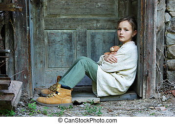 Sad little girl feels lonely.