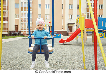 child swinging on a swing