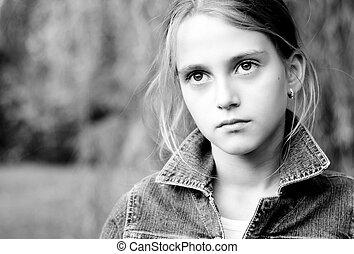 Sad little girl with big eyes.