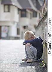 sad lonely boy on street - sad and unhappy alone child cry...