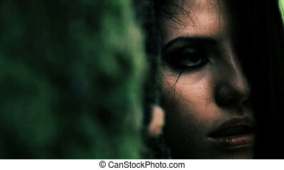 Close up of desperate woman crying near tree