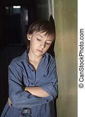 Sad lonely little boy