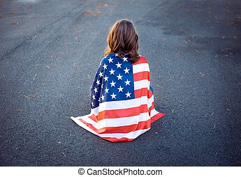 Sad lonely patriot woman sitting down with the american flag...
