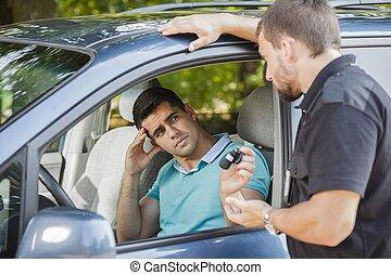 Sad man and car keys