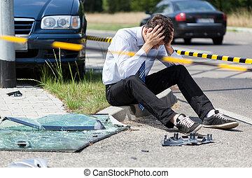 Sad man at accident scene - Sad man at road accident scene,...