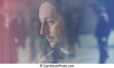 Adult caucasian sad man standing by the window of his living room and crying in despair. 1920x1080 full hd footage