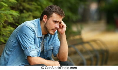 Sad man complaining in a park