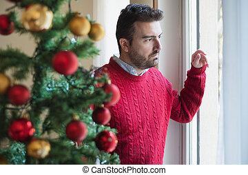Sad man feeling bad during christmas days