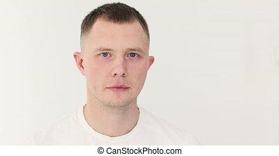 Sad man looking at camera on white background