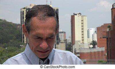 Sad Man near Buildings