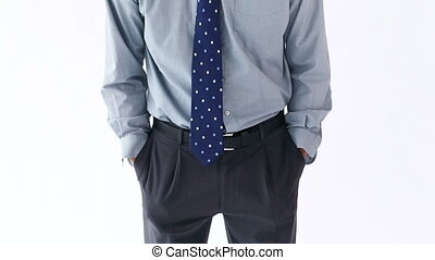 Sad man showing his empty pockets against a white background