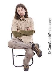 Sad man sitting on a chair
