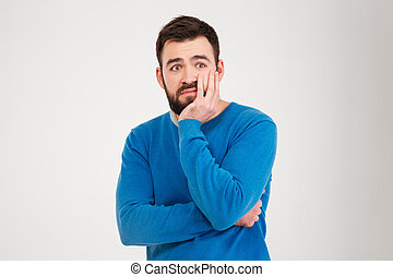 Sad man standing isolated on a white background
