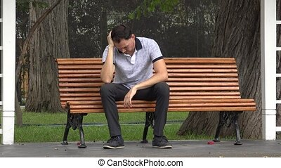 Sad Man With Loneliness Sitting In Park