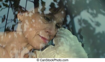 Sad mature woman in the car - Melancholy elderly woman at...