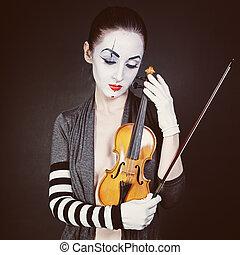 Sad mime with violin