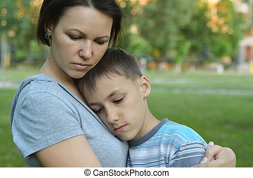 Sad mother with son  in  park