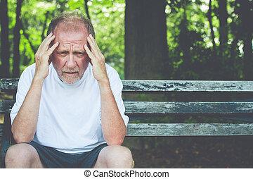 Sad old man brooding on bench outside - Closeup portrait, ...