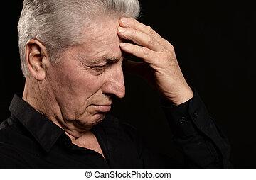 Portrait of a sad old man close-up