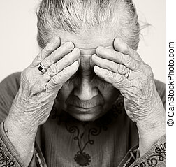Sad old senior woman with health problems - Unhappy old...