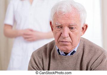 Sad older man - Sad older lonely man sitting at nursing home