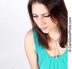 sad pensive girl on a white background