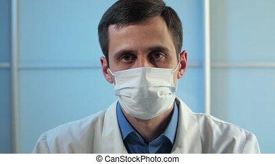 Sad physician at office looks at camera