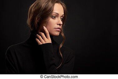 Sad pretty woman looking away wearing turtleneck. Beautiful...