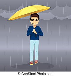 Sad Raining Man - Sad hopeless man holding yellow umbrella...