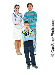 Sad schoolboy in front of parents