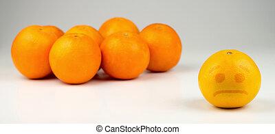 Sad orange ostracized by darker, taller oranges.
