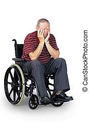 Sad senior in wheelchair