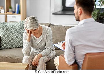 sad senior woman patient and psychologist