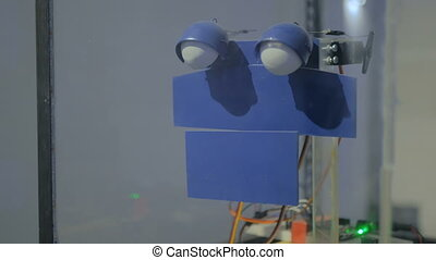 Sad simple handmade robot at technology exhibition - Sad...