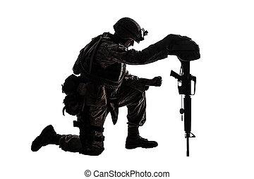 Sad soldier kneeling because of friend death - Army soldier...
